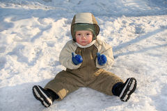 Boy on snow Royalty Free Stock Images