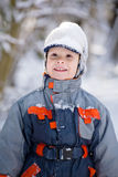 Boy and snow cap Royalty Free Stock Photos