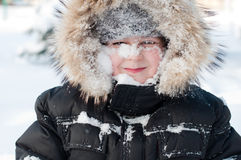 Boy with snow on her face Royalty Free Stock Photos