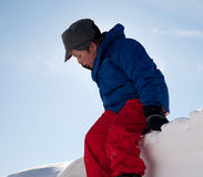 Boy in the snow mountain Royalty Free Stock Photos