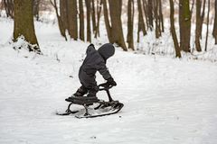 Boy and snow racer in winter Royalty Free Stock Photo