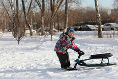 Boy with a snow racer Royalty Free Stock Image