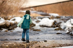 Boy with snow on river Royalty Free Stock Photos