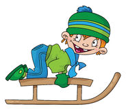 Boy on a snow sled Royalty Free Stock Image