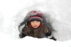 Boy in snow tunnel. Young boy playing in snow tunnel Royalty Free Stock Image