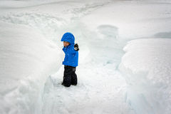 Boy in the Snow Tunnels Stock Photography