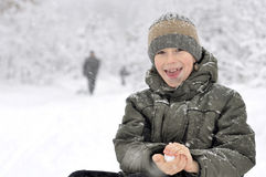 Boy with snowball Stock Photos