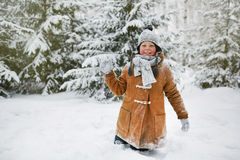 Boy with snowball Royalty Free Stock Photo