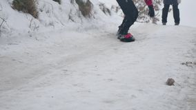Boy snowboarding in the snow with a winter holidays. Boy snowboarding in snow with a winter holidays stock footage