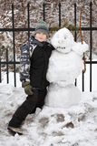 Boy and snowman Royalty Free Stock Photo