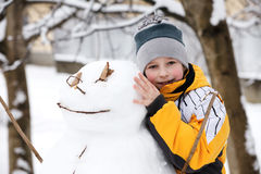 Boy and a snowman Royalty Free Stock Photography