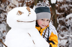 Boy and a snowman Royalty Free Stock Photos