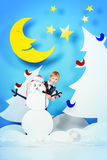 Boy and snowman royalty free stock image