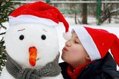 Boy with snowman. Stock Photos