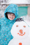 boy and a snowman - winter holiday Royalty Free Stock Photography
