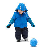 Boy in a Snowsuit with a Ball - Isolated Royalty Free Stock Photography