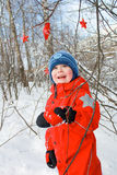 Boy in the snowy forest Stock Photos