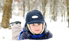 Boy at snowy winter outdoors Stock Photography