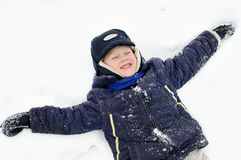 Boy at snowy winter outdoors Royalty Free Stock Photography