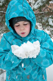 Boy  the snowy winter park Stock Photo
