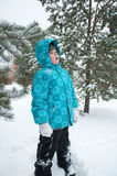 Boy  the snowy winter park Royalty Free Stock Photos