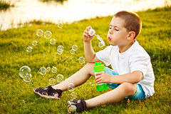 Boy and soap bubble Royalty Free Stock Image