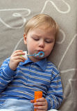 Boy and soap bubble. Boy, blowing soap bubble Royalty Free Stock Photography