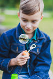 Boy and a soap bubble Stock Image