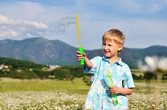 Boy and soap bubbles Stock Photo