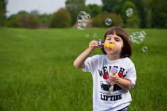 Boy and soap-bubbles Stock Photos