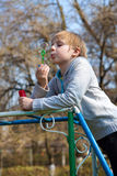 Boy with soap bubbles Stock Photos