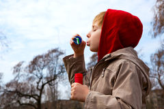 Boy with soap bubbles. Against a sky Stock Photos
