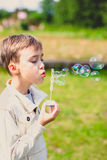 Boy and soap bubbles Stock Images