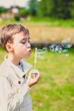 Boy and soap bubbles Stock Photos
