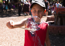 A boy and soap bubbles. A boy plays with soap bubbles Royalty Free Stock Photos