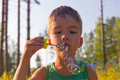 Boy and soap bubbles Royalty Free Stock Images