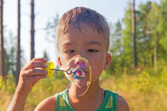 Boy and soap bubbles Royalty Free Stock Image
