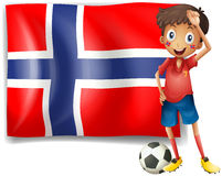 A boy with a soccer ball in front of the flag of Norway Stock Images
