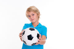 Boy with soccer ball in front of white background Stock Photos