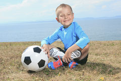 The boy with soccer ball Royalty Free Stock Photos
