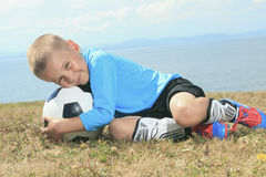 The boy with soccer ball Stock Images