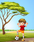 A boy with a soccer ball Royalty Free Stock Photos