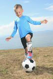 The boy with soccer ball Stock Photo