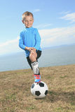 The boy with soccer ball Stock Photography