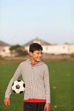 Boy with soccer ball outside Stock Photo