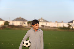 Boy with soccer ball outside Royalty Free Stock Photos