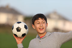 Boy with soccer ball outside Stock Photos
