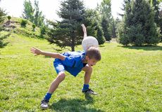 Boy with soccer ball in park on nature at summer. Royalty Free Stock Photo