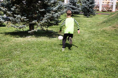 Boy with soccer ball in park on nature at summer Stock Images