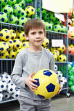 Boy with soccer ball in sport store Stock Photography